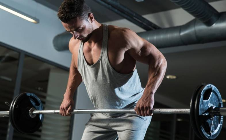 the barbell row requires total body stabilization as you are in a bent over position with the free moving loaded barbell