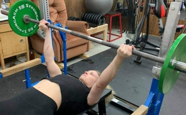 the reverse grip bench press is performed by literally holding the bar with your fingers facing the top of your head rather than your legs