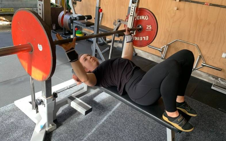 set up in a rack with a flat bench