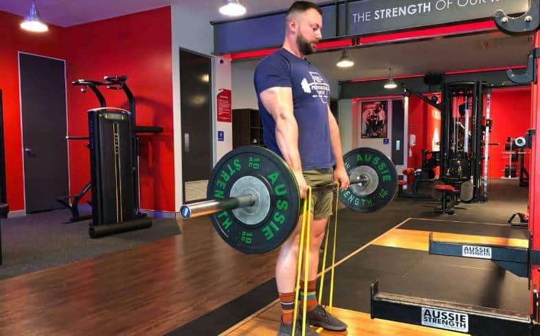 the bands in the banded deadlift promote acceleration through the upper half of the pull