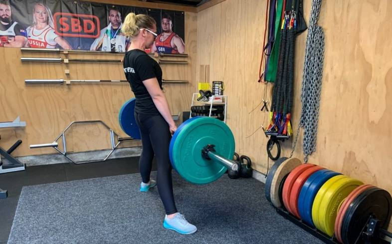 hips through is to help a lifter lock out their lift as quickly as possible