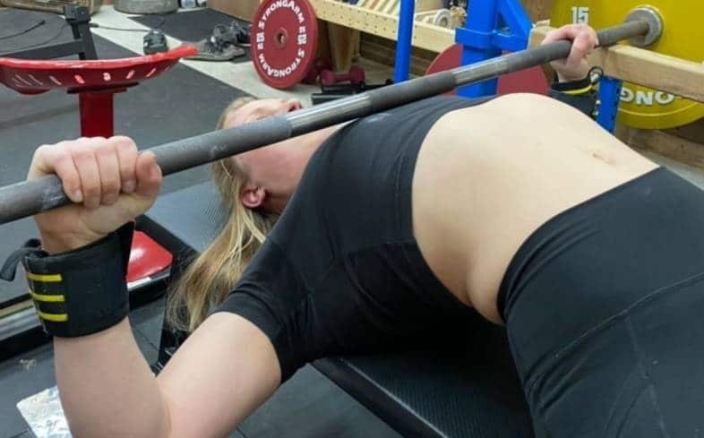 the dead bench press involves pressing from the safeties rather than the chest