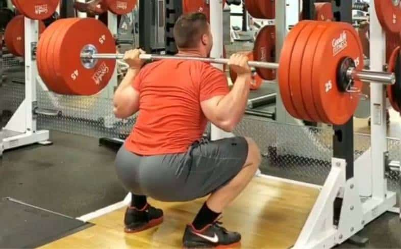 To feel the glutes more in a squat focus on driving the hips forward and up as we extend out of the bottom position