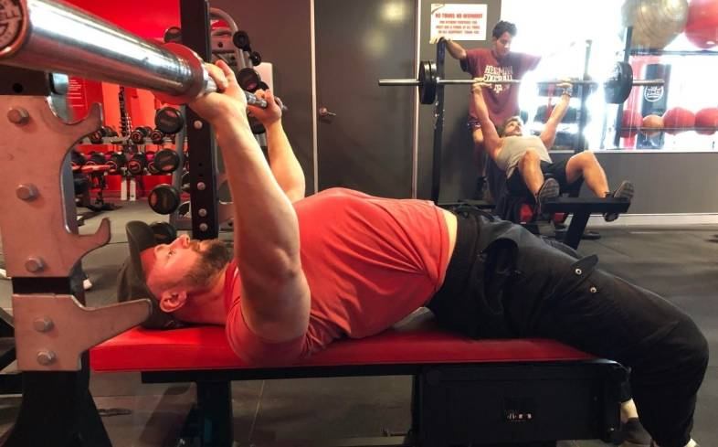 to feel the pecs while benching we need to ensure that we are getting full range of motion