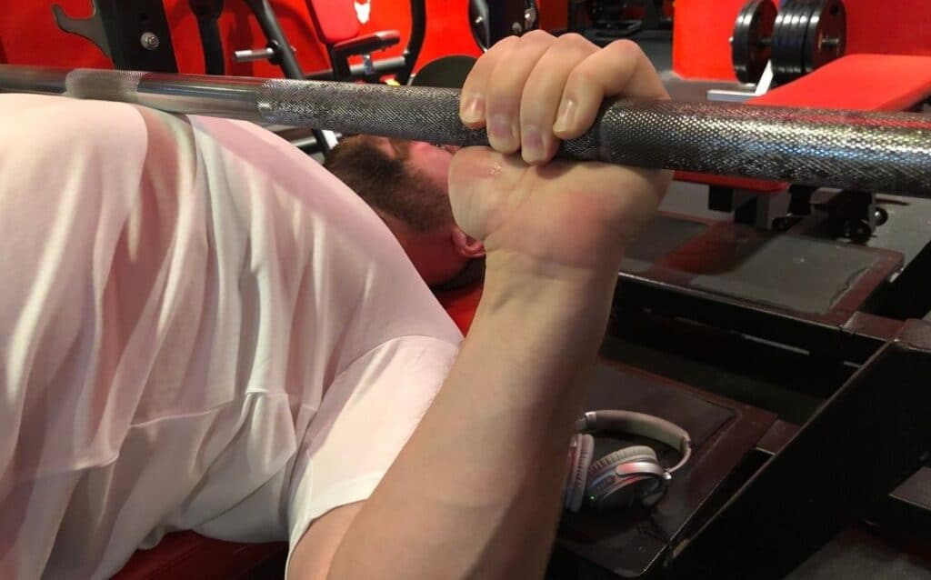 maintain control off of the bottom position and minimize the use of momentum to elevate the bar