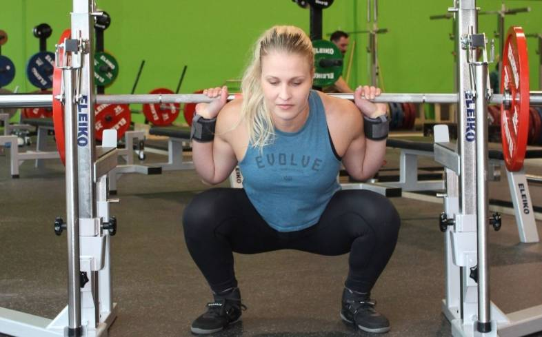 maintain tension in the bottom position of the squat in order to feel the glutes