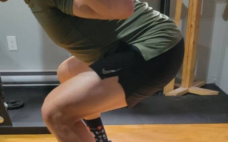 switching to a low bar style of squatting will help us feel the glutes more while squatting
