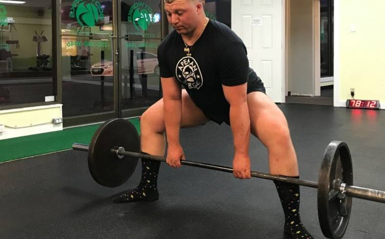 the sumo deadlift is often called out for being cheating because it appears to be an easier lift mostly due to a reduction in range of motion