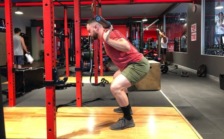 the partial squat performs with a high bar or low bar position, but is only a partial range of motion